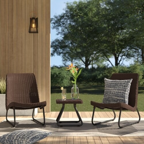 Two resin wicker chairs and a side table outside