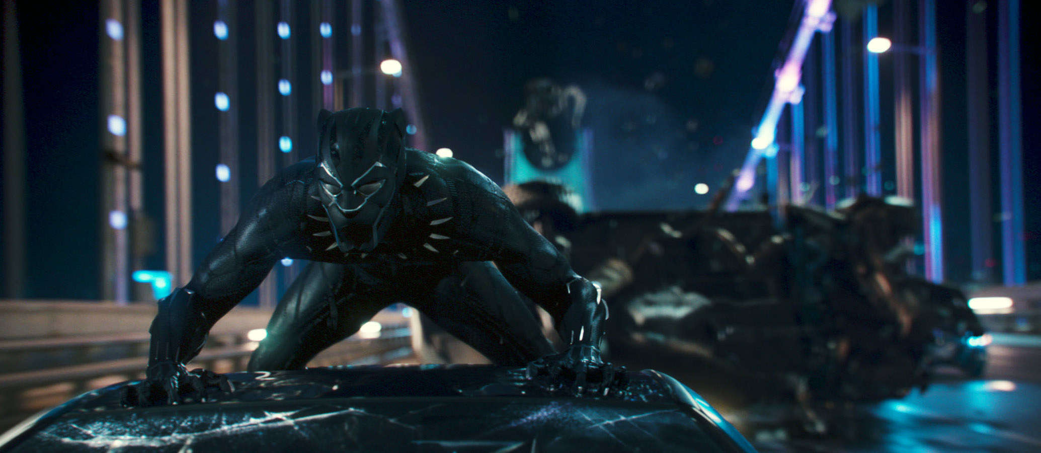 Chadwick Boseman as Black Panther on top of a moving vehicle