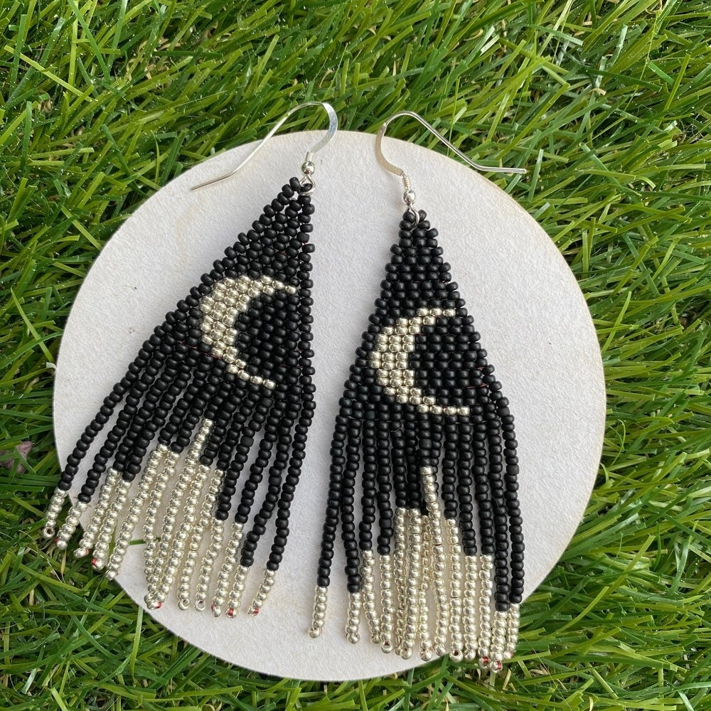 black and silver fringe earrings with moons on them
