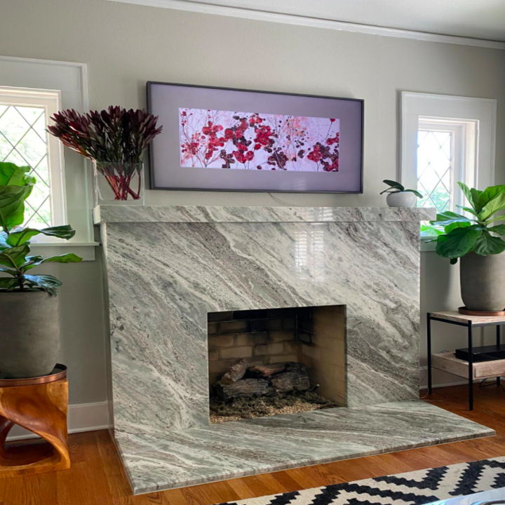 reviewer photo showing Samsung frame above a fireplace