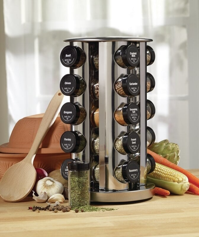 a spice rack filled with spices on a counter