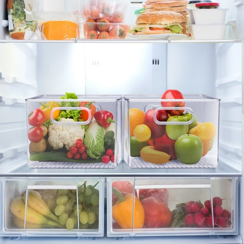 acrylic bins in a fridge holding fruits and vegetables