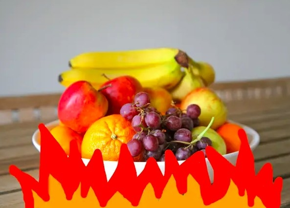 Image of a bowl of fruit being heated by a cartoonish fire