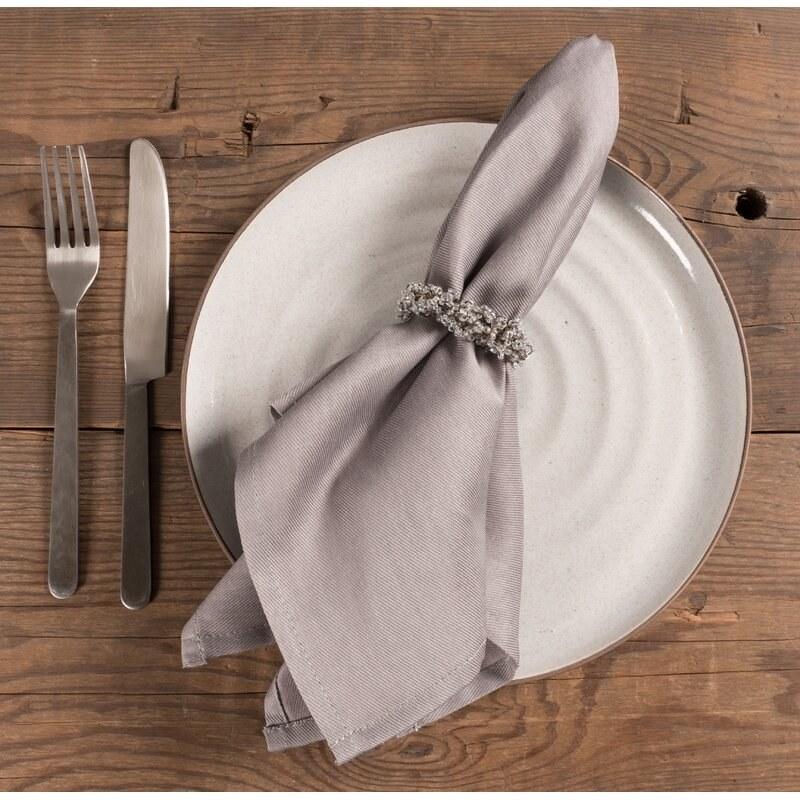 a taupe cloth napkin on a plate setting