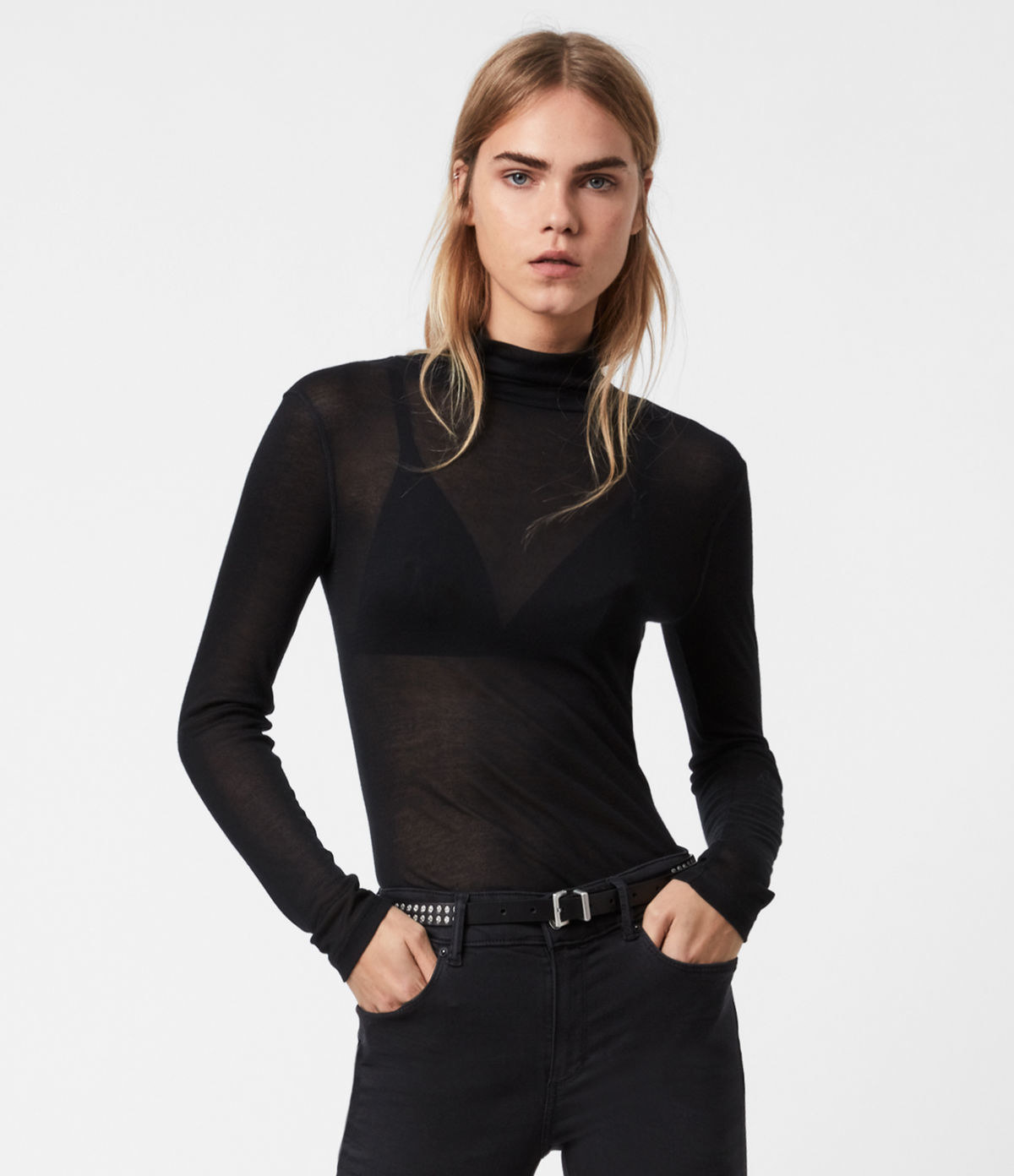 Model wearing black roll neck top