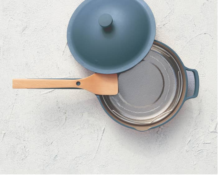 The blue matte pan with beechwood spatula and steamer basket