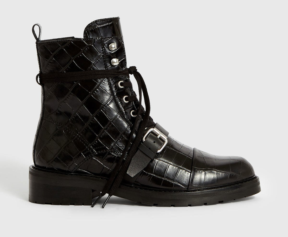 Photo of black crocodile skin boots