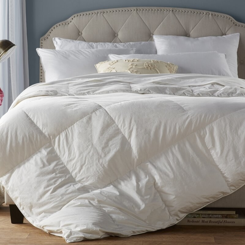 a white down alternative comforter on a bed