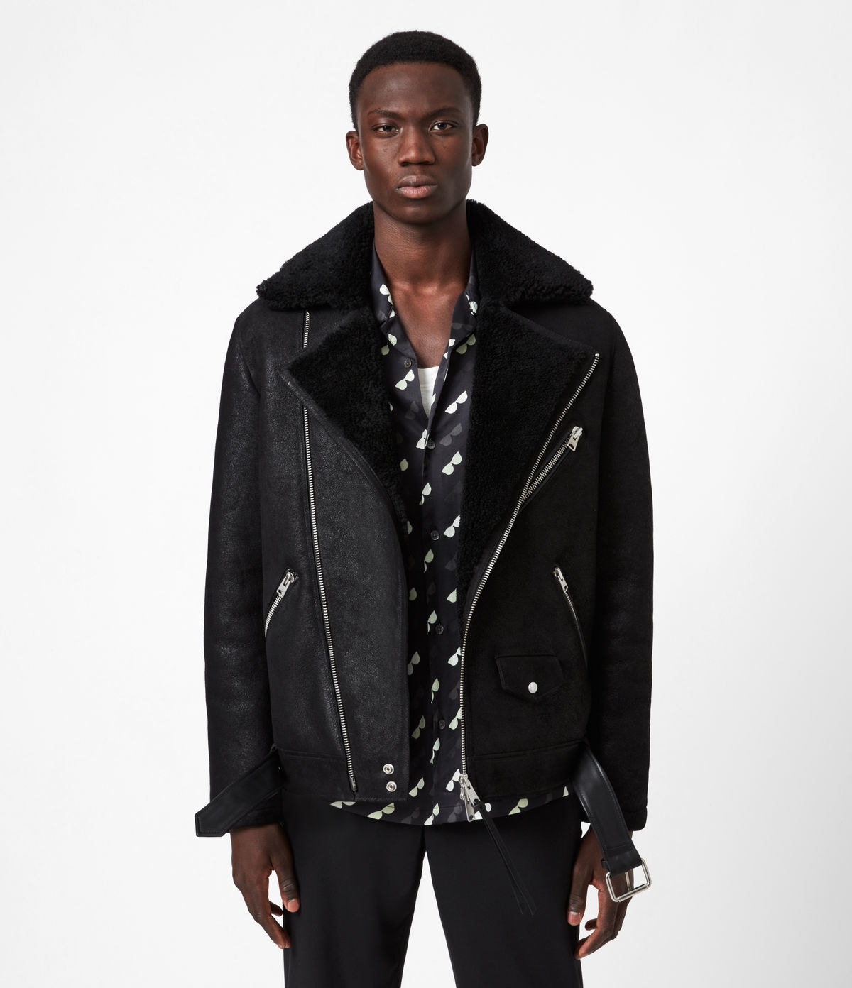 Model wearing black shearling jacket