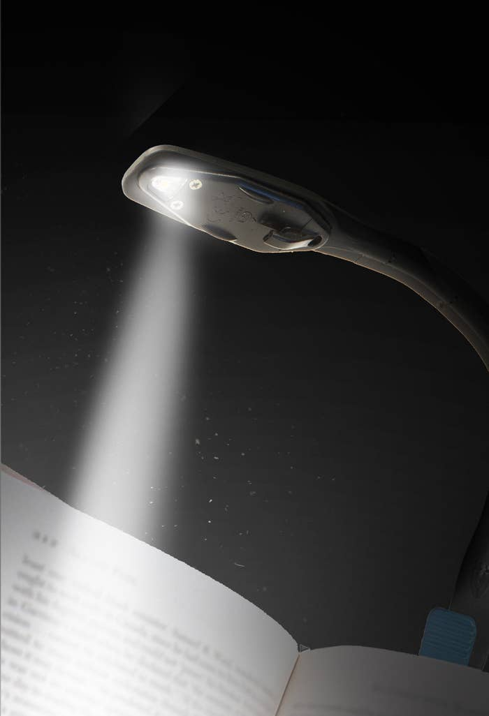 Black clip-on light with blue details