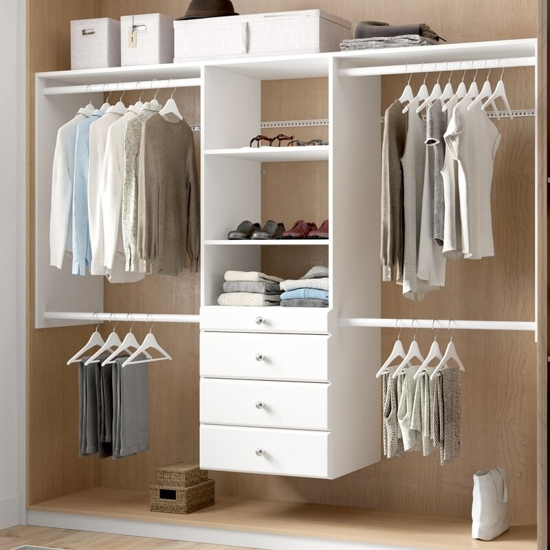a white storage system with three shelves four drawers and four racks for hanging