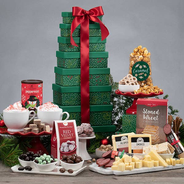 Christmas tree colored boxes stacked with red ribbon. All treats around packaging.