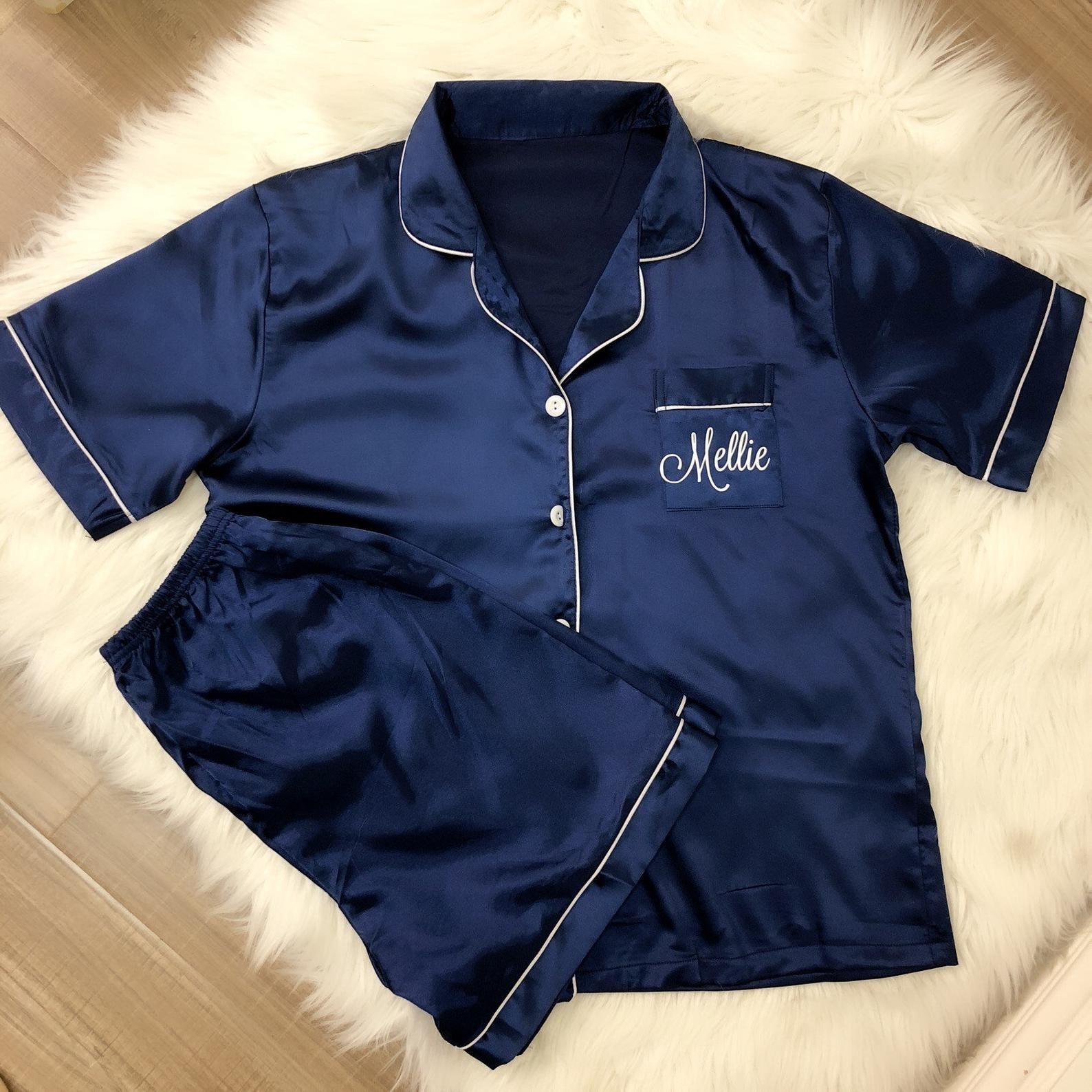 """navy blue pajamas with """"mellie"""" embroidered on the pocket"""