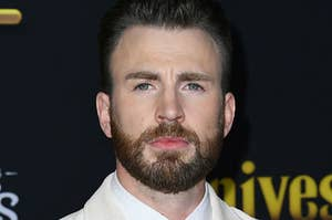 """Chris Evans posing on the red carpet for """"Knives Out"""""""