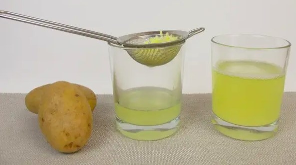 Picture of potato next to two glasses filled with potato water