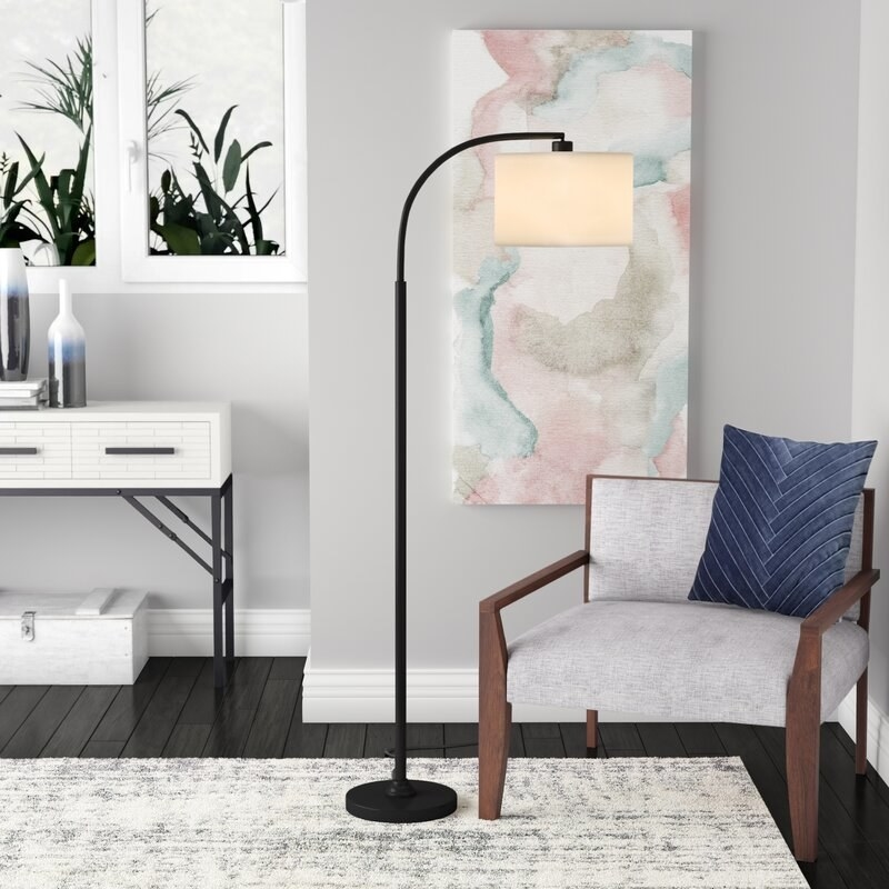 a black arch lamp in a living room