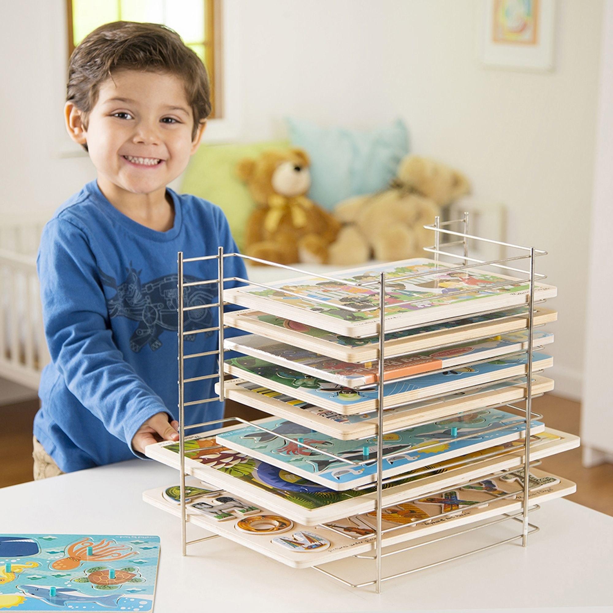 Model uses the metal puzzle storage rack