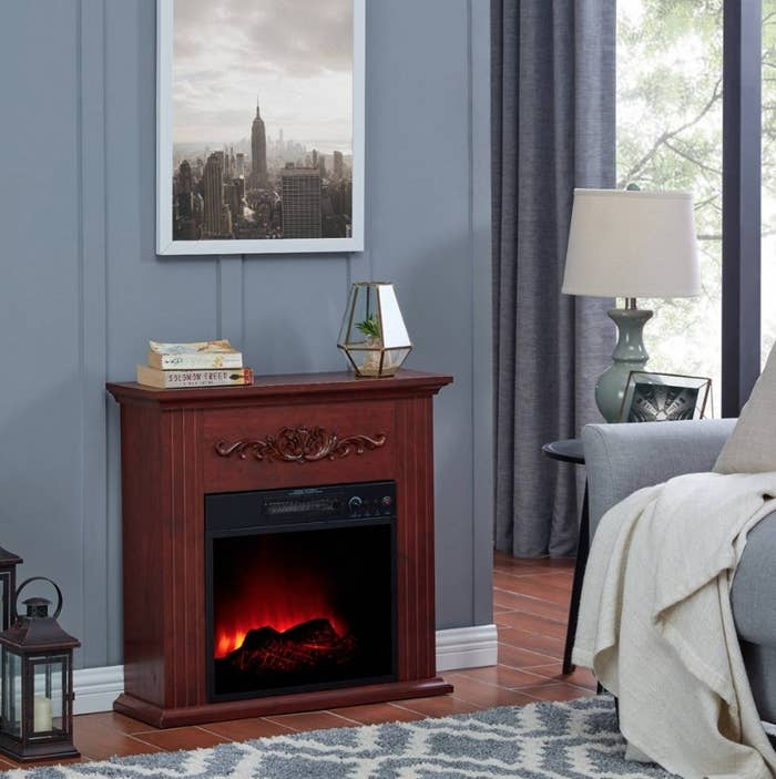 Mahogany electric fireplace against gray wall