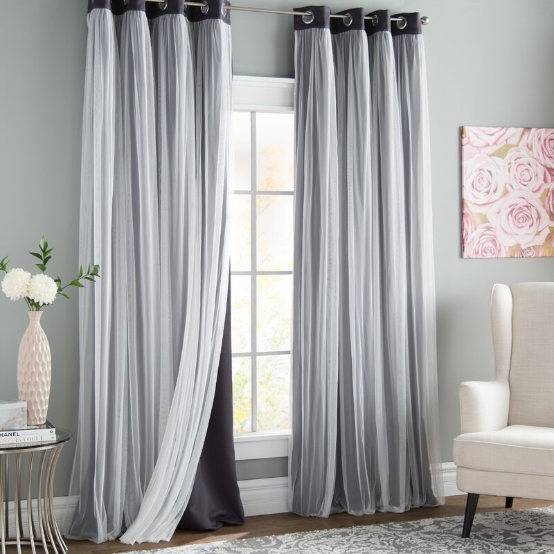 a set of grey black out curtains in a living room