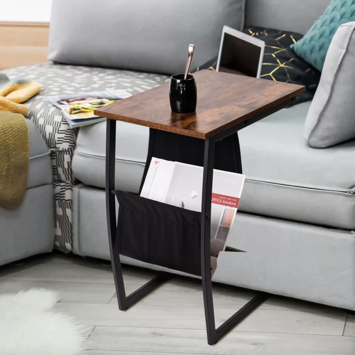 The end table with storage holding magazines
