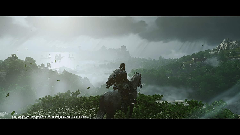 A samurai on horseback overlooking a beautiful forested mountain kingdom