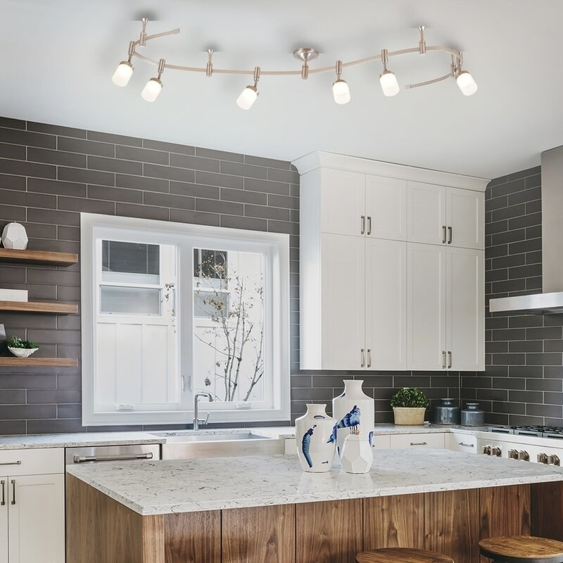 an s-shape tracking light mounted on the ceiling in a kitchen