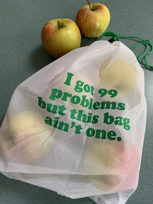 """a mesh bag with """"I got 99 problems but this bag ain't one"""" on it"""