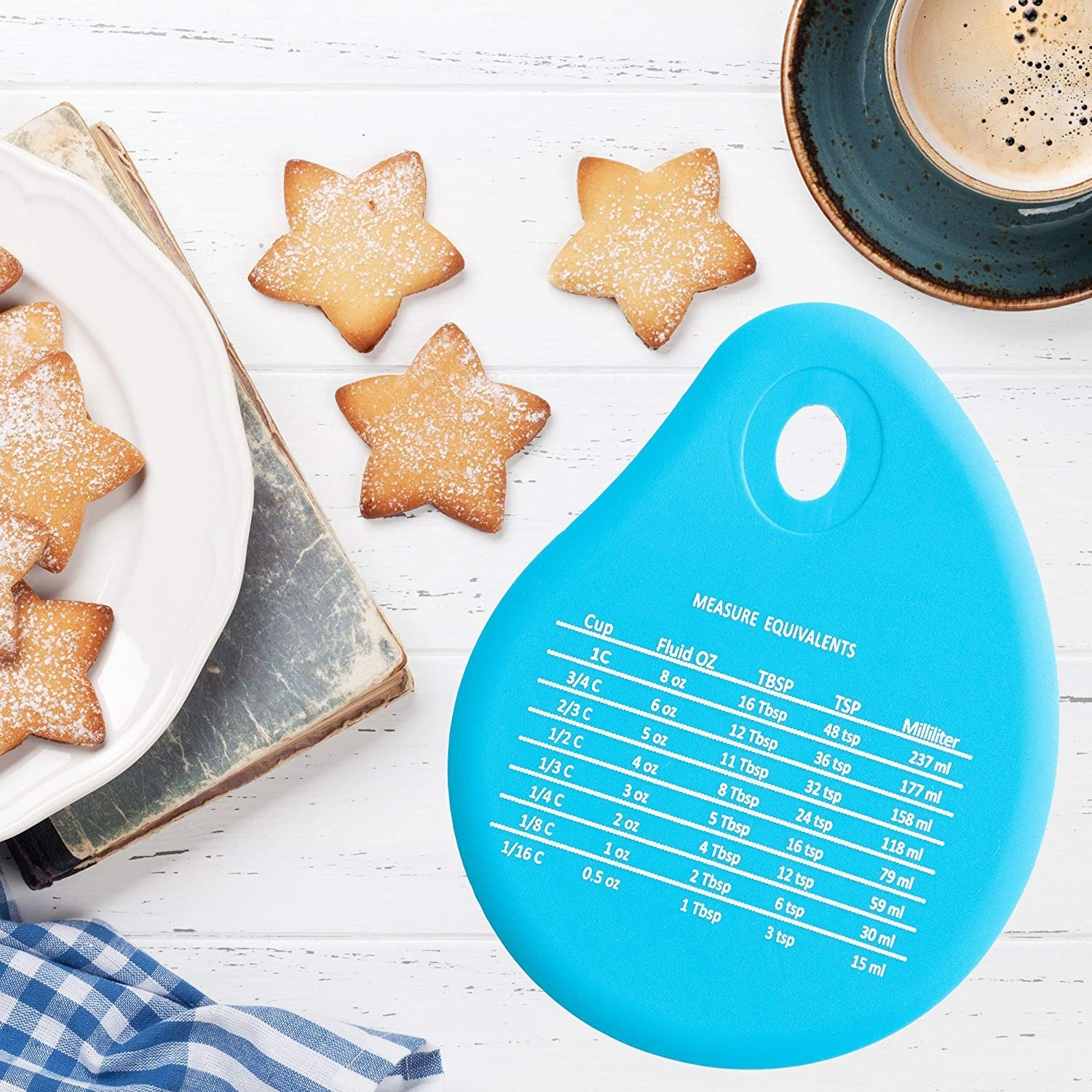 A silicone spatula next to star-shaped sugar cookies