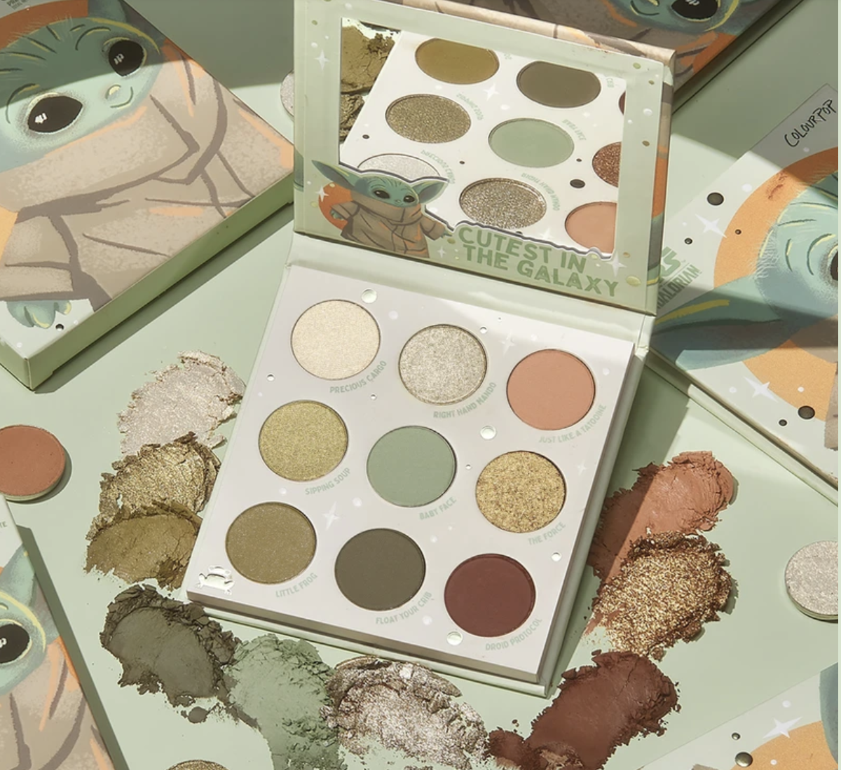 An eye pallette with shades of bronze, green, silver, ivory, and brown themed to Baby Yoda from The Mandalorian