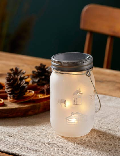 A mason-jar inspired table lantern with rustic designs