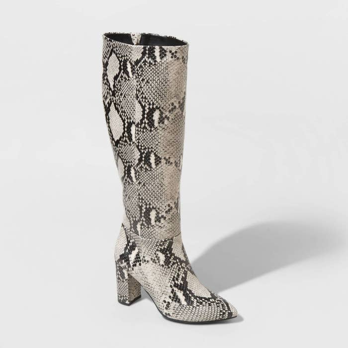 Black and white snakeskin tall boots