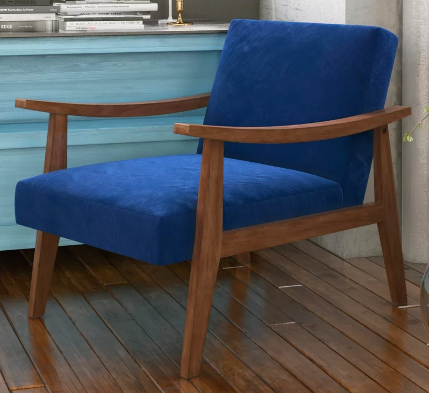 The armchair in azure with wood arms and legs