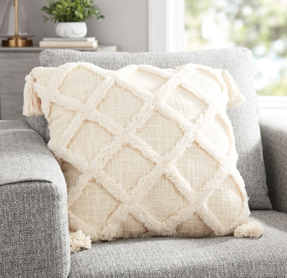 Off white tufted decorative pillow