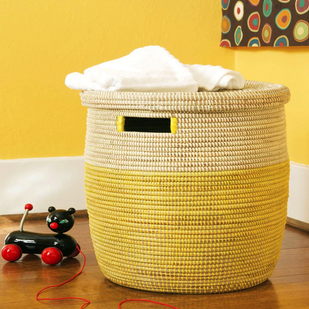 the woven hamper is natural colors of tan and bright yellow