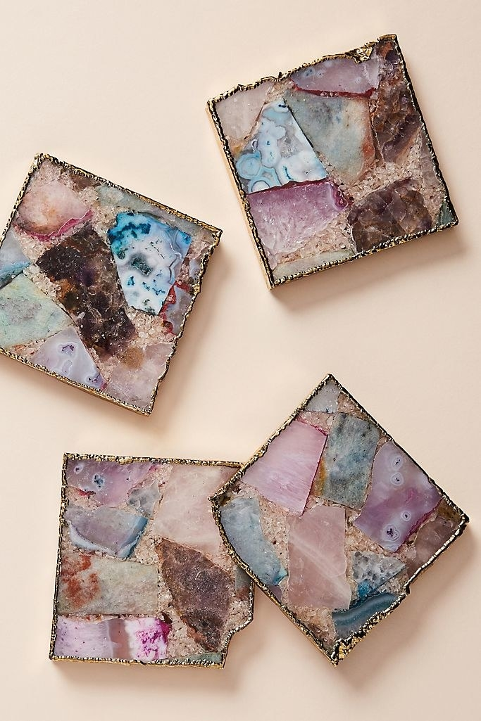 Four coasters with multiprint geodes rimmed with gold