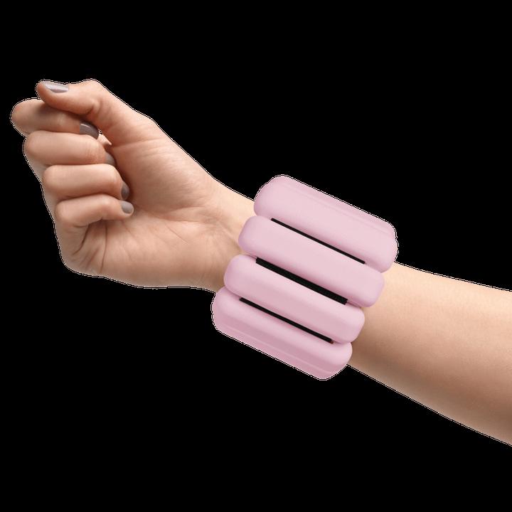 A model wearing a pink Bala Bangle on her wrist