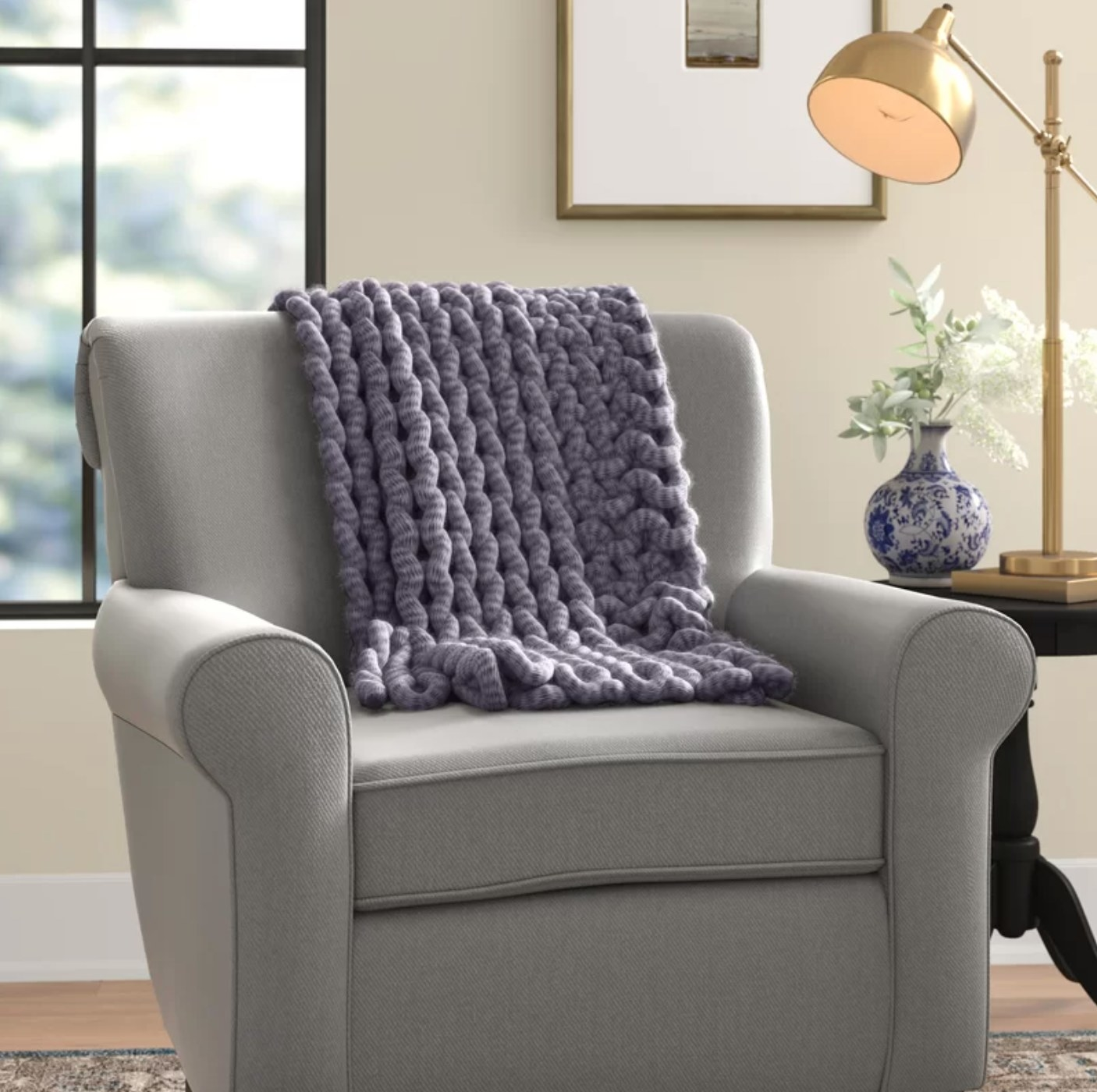 The knitted acrylic throw in indigo