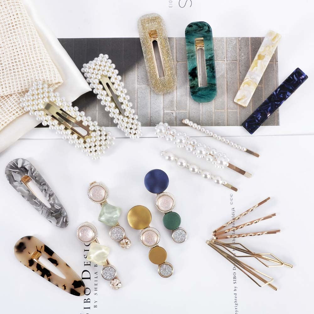 A set of 20 acrylic pearl-esque hair barrettes in different patterns and styles