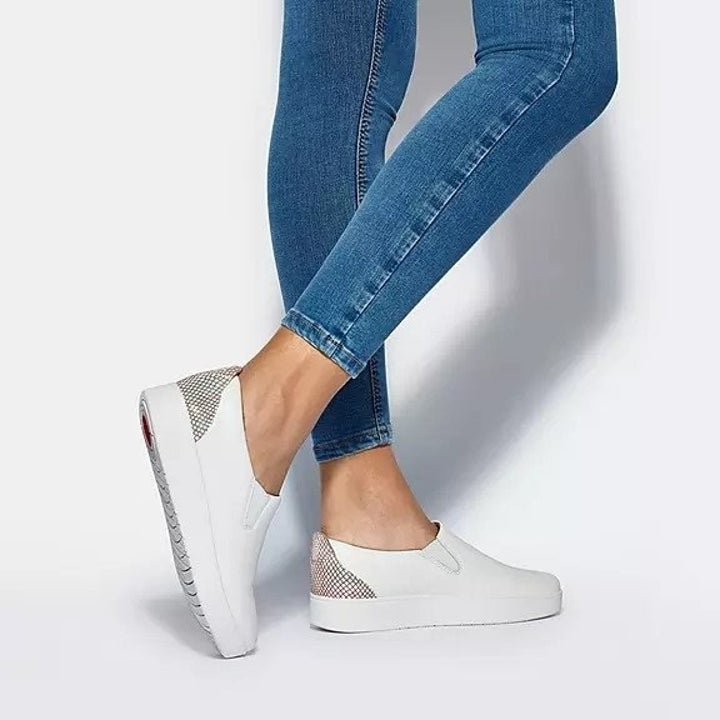 white ankle-height slip-on sneakers with accented heel