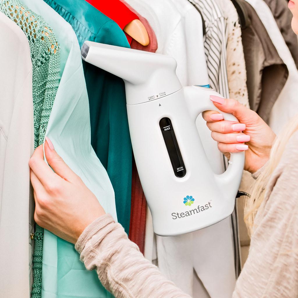 Model uses the white steamer on a light blue blouse