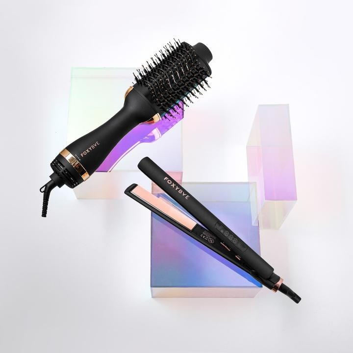 A hair straightener and a round brush dryer