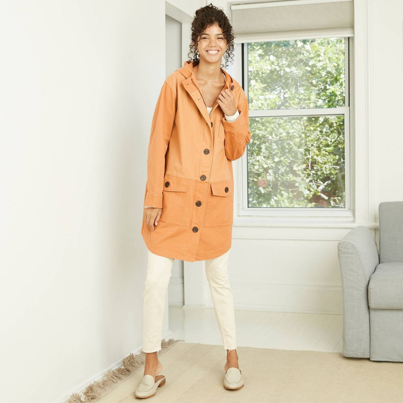 Model in orange mid length colorblock jacket