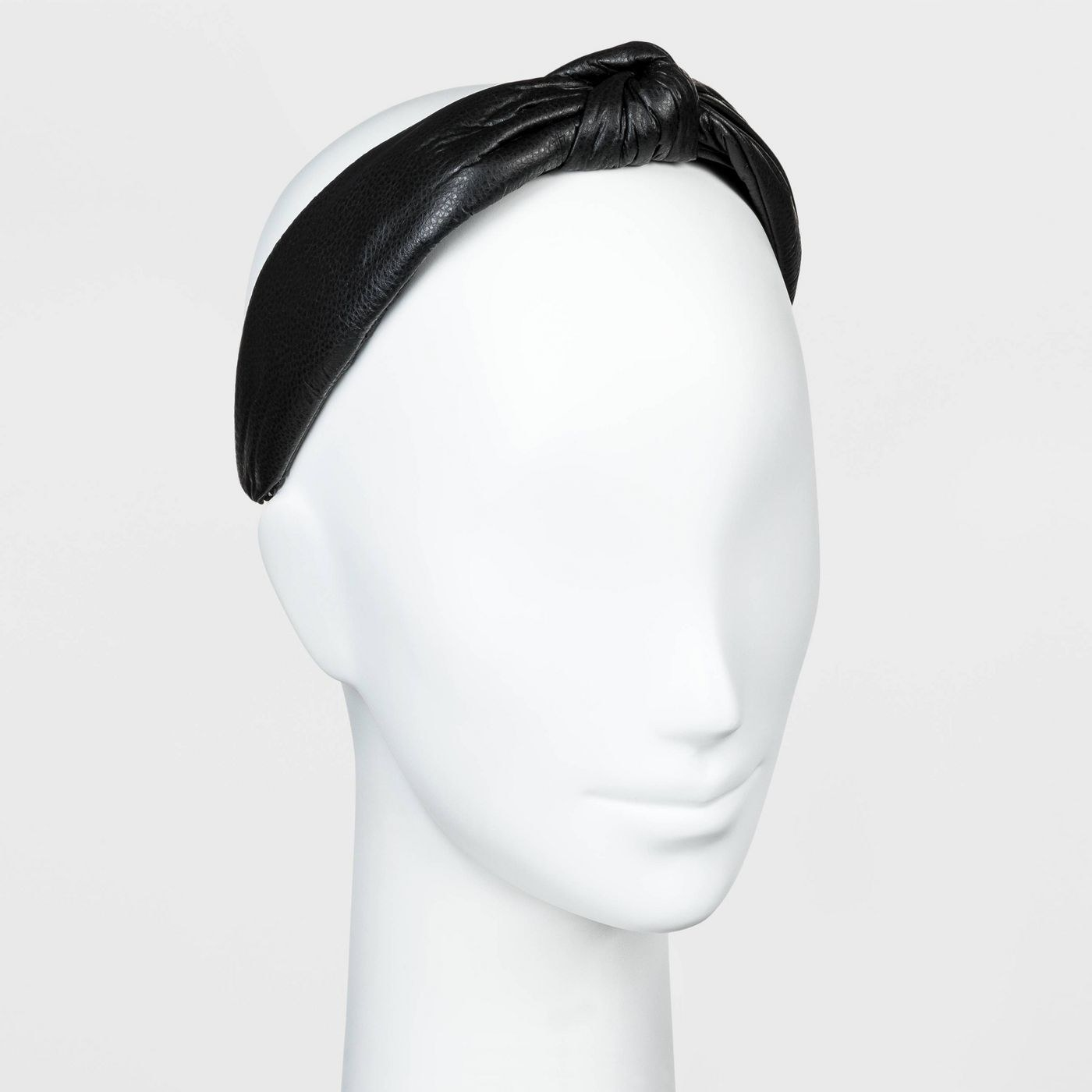 Black faux leather top knot headband