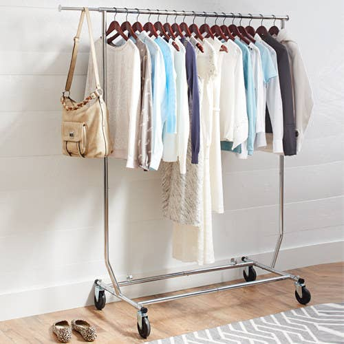 The metal rack holding several pieces of clothing