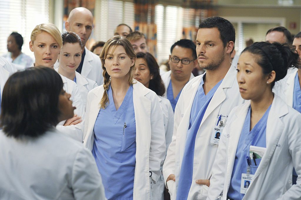 All of the interns looking at Dr. Bailey while she tells them about the domino surgery.