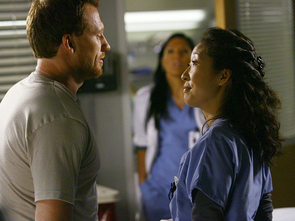 Owen and Cristina talking to each-other in the hospital.