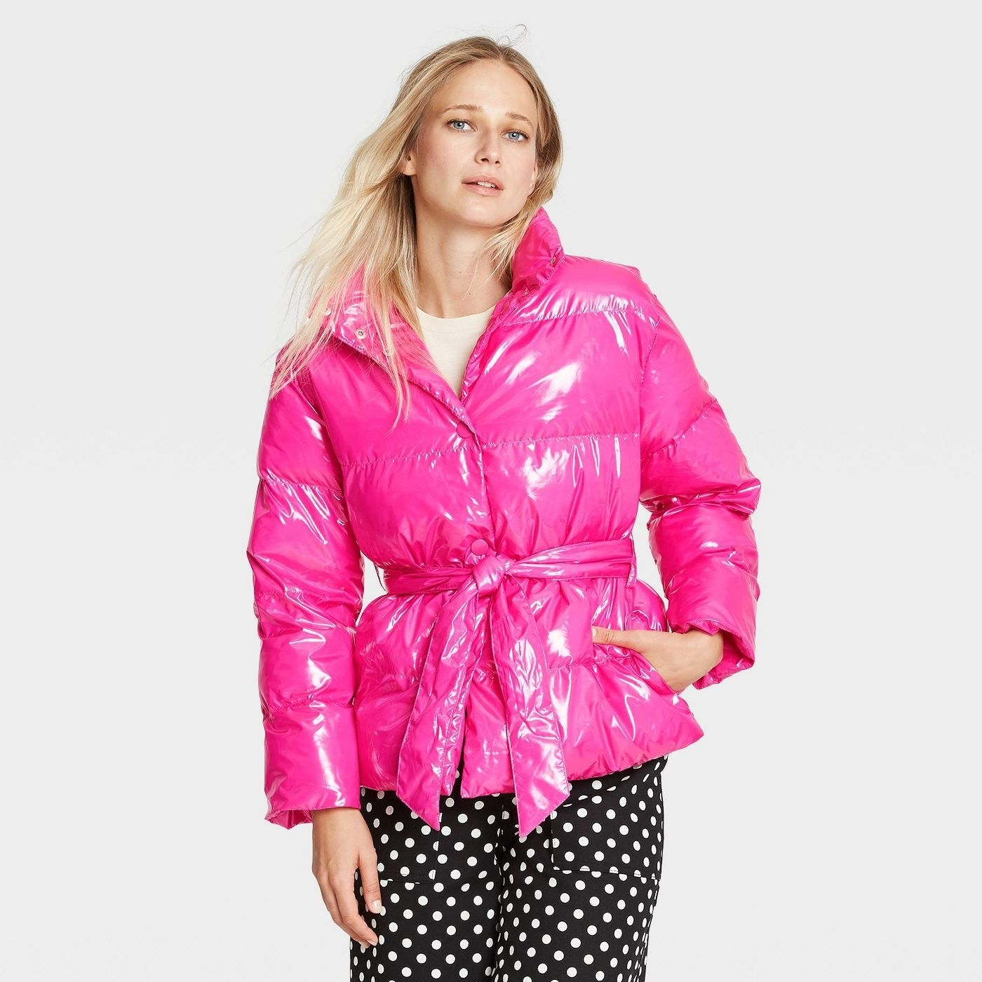Model in pink tie waist puffer jacket