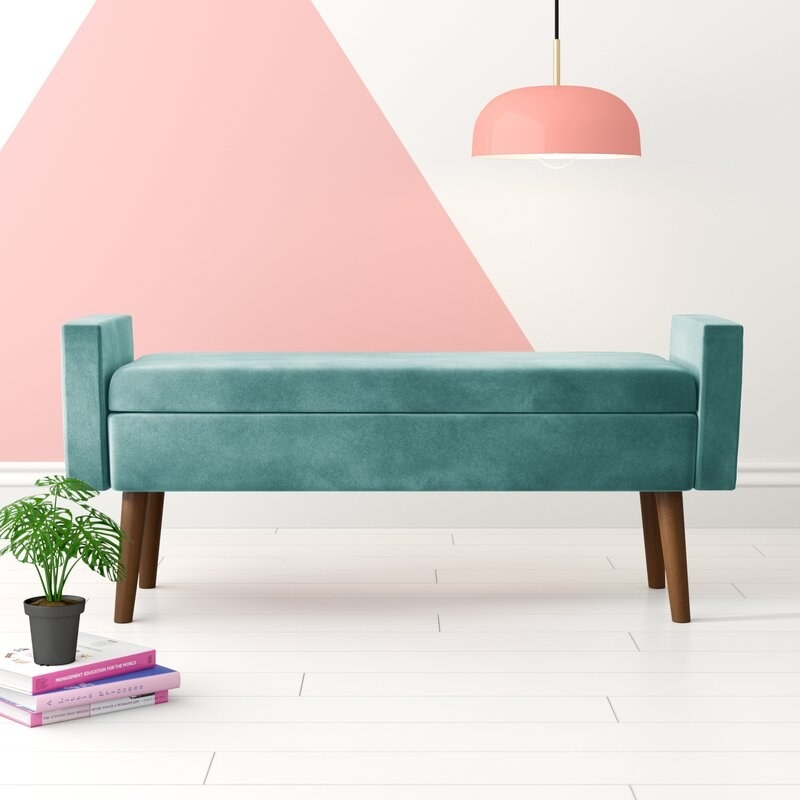 The teal storage bench