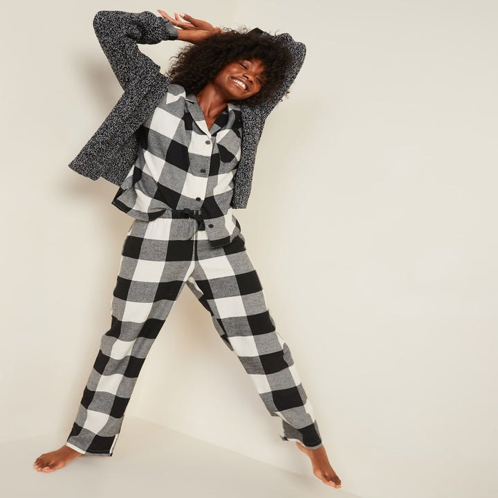 model wearing black and white gingham pjs