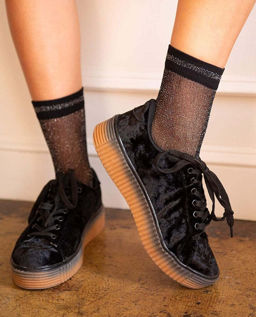 model wearing the black glittery socks with black sneakers